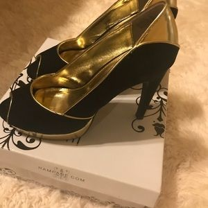 Peep toe black and gold heels. Excellent condition